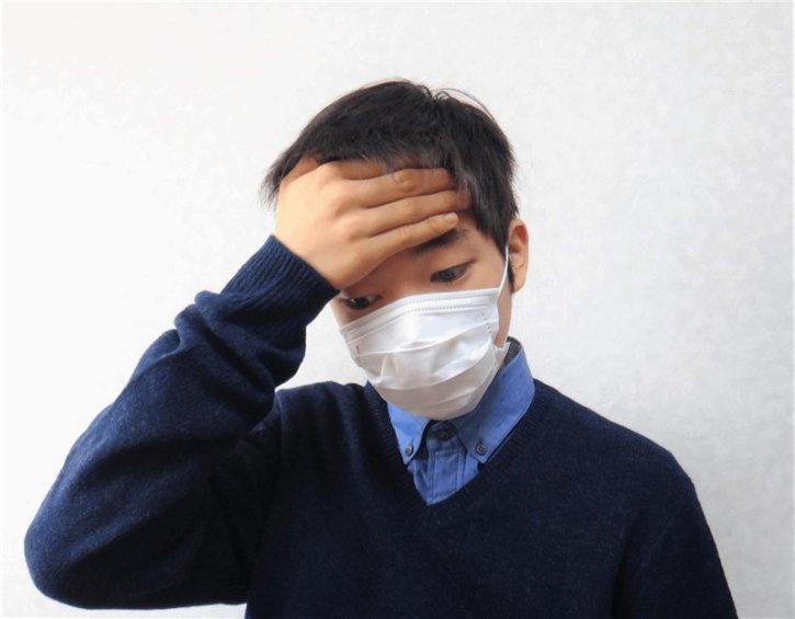 熱がある少年